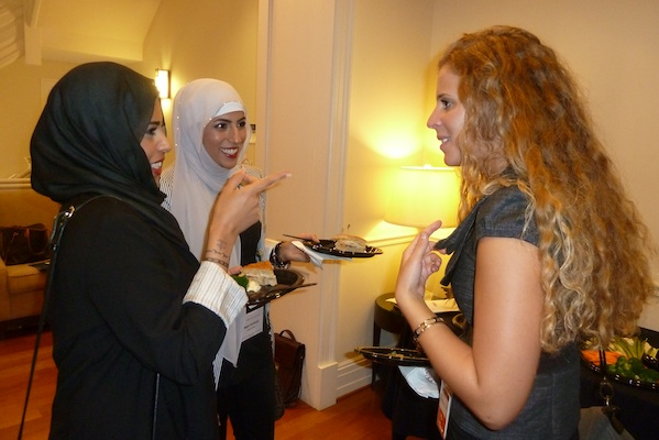 Saara and Najat (Kuwait) get tips from a Washington Center
