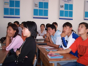 Kyrgyz students listen to a presentation on civic responsibility